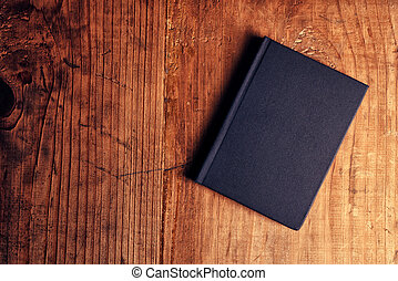 Black notebook on wooden office desk, top view