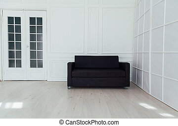 black office sofa in the interior of the white room