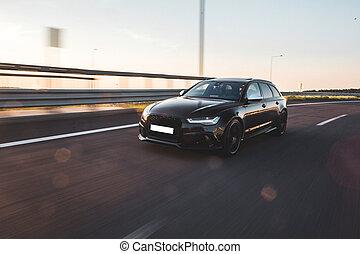 Black offroader car on the road