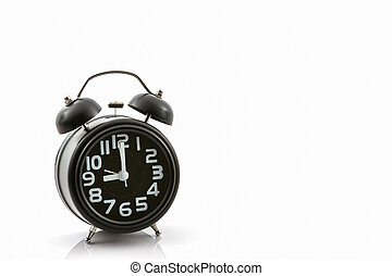 Black old fashion alarm clock.