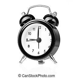 Black old style alarm clock isolated on white
