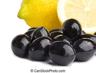 black olives and lemon on white