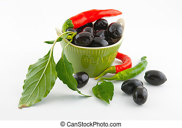 Black olives and red pepper - Black olives in a green...