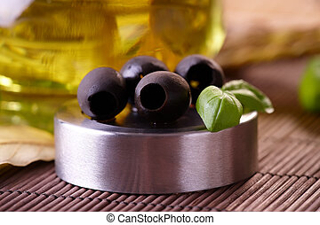 Black Olives - Black olives with fresh basil and oil in...