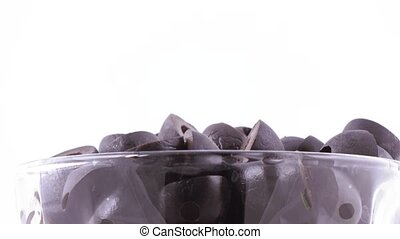 Black olives in the bowl - Mass of black olives in a glass...