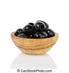 black olives in wooden bowl, isolated on white