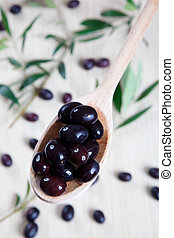 Black olives - Olives in a wooden spoon