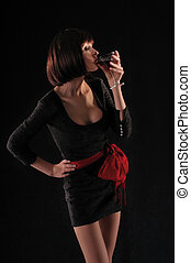 black on black - girl in black on a black background