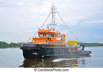 Black-orange ship in Volga river, Yaroslavl, Russia