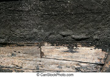 Black paint in wooden boat hull grunge aged