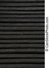Black painted log wall old architectural historic background