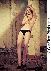black panties - Attractive nude woman in the old house.