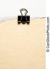 Black paper clip on white