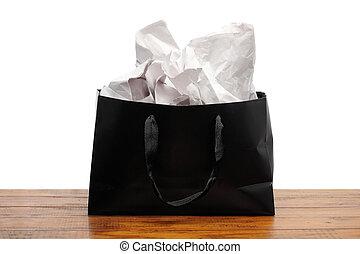 Black Paperbag on Wooden Background