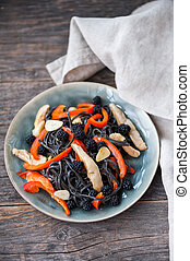 Black pasta with vegetables
