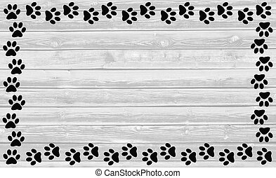 Black paw prints frame on wooden background. - Black paw...