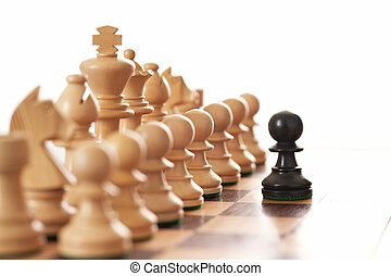Black pawn challenging army of white chess pieces