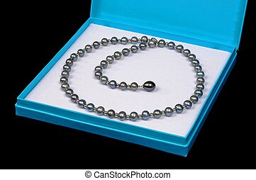 Black pearl necklace in a box.