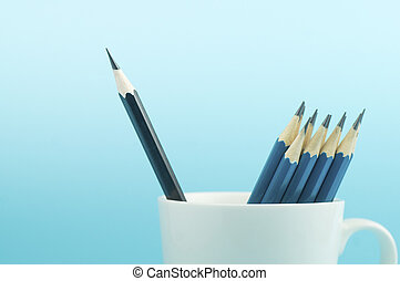 black  pencil, leader on blue background , different concept
