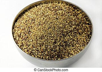 Black pepper powder - A close up of black pepper powder in a...