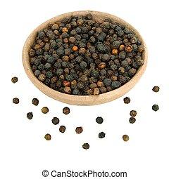 Black Peppercorns in a handmade clay bowl