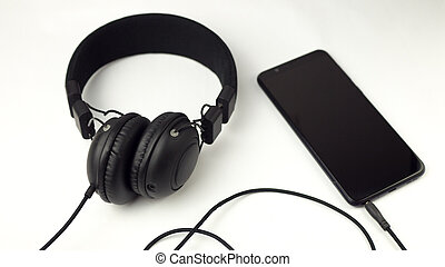 black phone with headphones on a white background