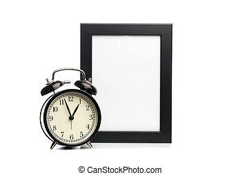 black photo frame and clock isolated on white background.