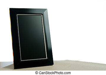 photoframe - black photoframe on the table in white...