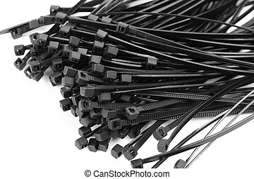 Black plastic ties clamps. Close up. Isolated on a white background