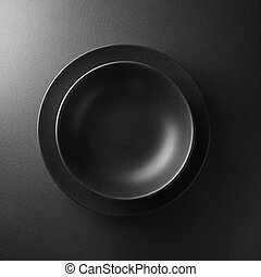 black plate on a background - serving two black plates on...