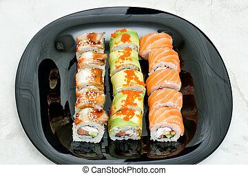 Black plate with various rolls. Top view