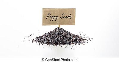 Black poppy seeds on white background