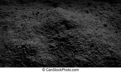 Black Powder Rotating - Pile of black powder turning slowly
