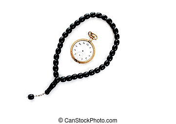 prayer beads and vintage pocket clock,time for praying