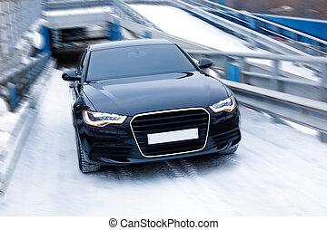 black prestigious car on snow - modern black prestigious car...
