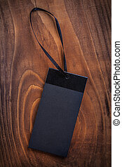 black price label tag on old wooden board