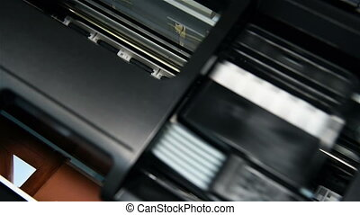 Printer Printing Photo - Black Printer Printing Photo. Close...