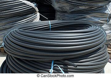 Black PVC hoses - Coiled black PVC hoses. Polyethylene...