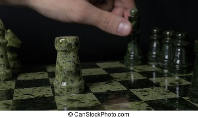 Black Queen defeated White rook. Set of chess figures on the playing board
