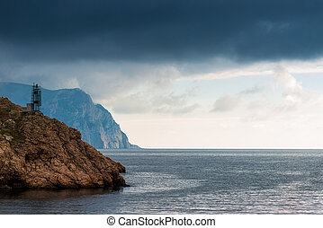 Black rain clouds over the sea, dramatic landscape on a cloudy day