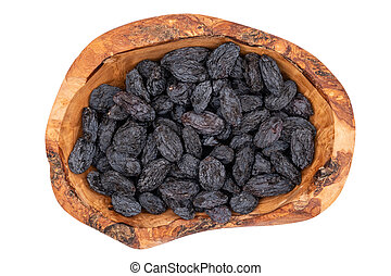 Black raisins in wooden bowl isolated on white.