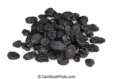 Black raisins on a whit background