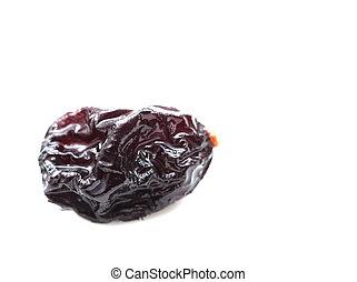 black raisins on a white background