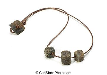 Black raw amber necklace isolated o
