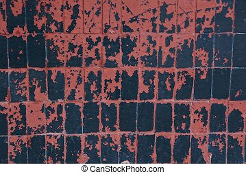 black red texture of old shabby tiles on the wall