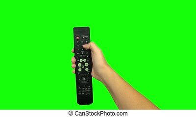 Black remote control television changing one channel . Green...