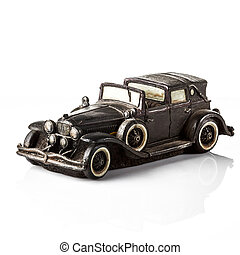Black retro car model on a white background.