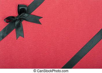 Black ribbon on red background