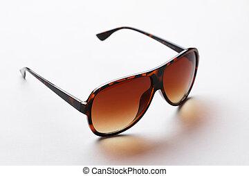 Black-rim glasses with brown lenses