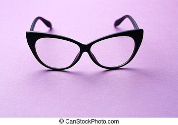 Black-rimmed glasses with clear lenses